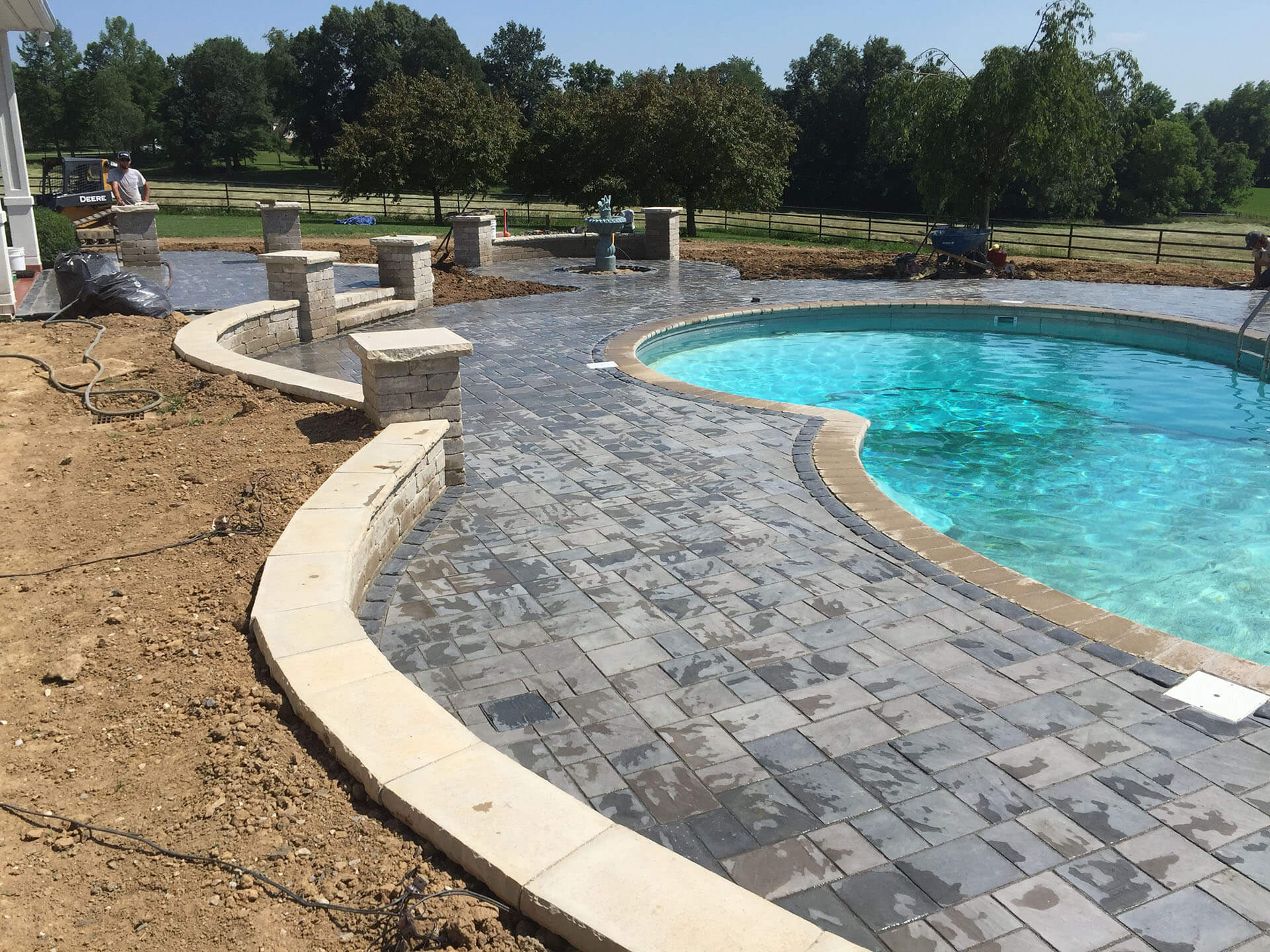 installation of a stone pool deck at a home in Jackson, MO Project