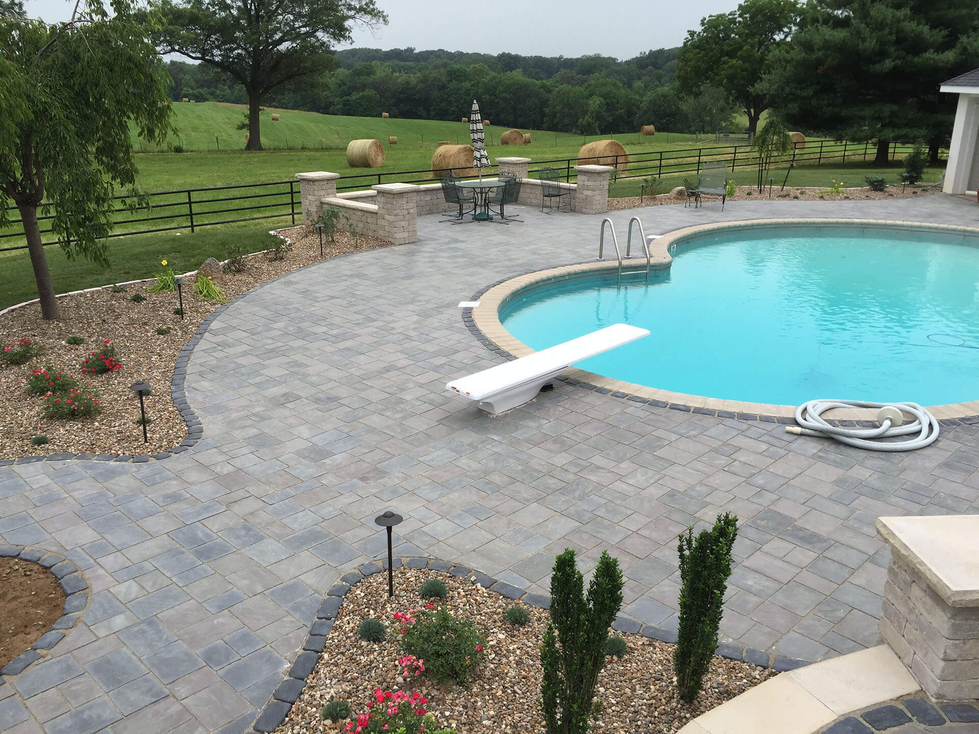 natural stone pool deck and garden features for a home in Jackson, MO Project