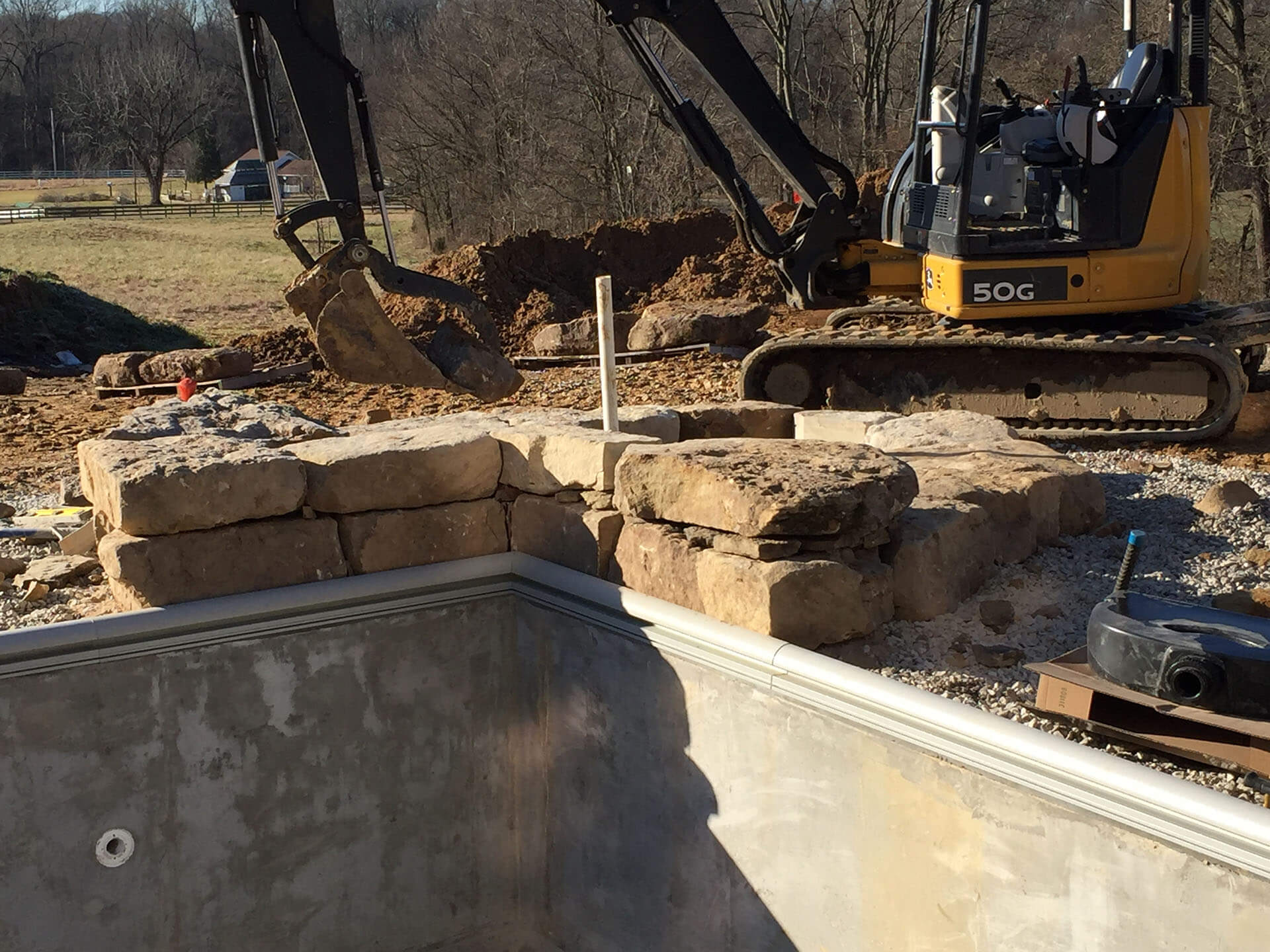 building a natural stone waterfall feature Cape Girardeau, MO Project