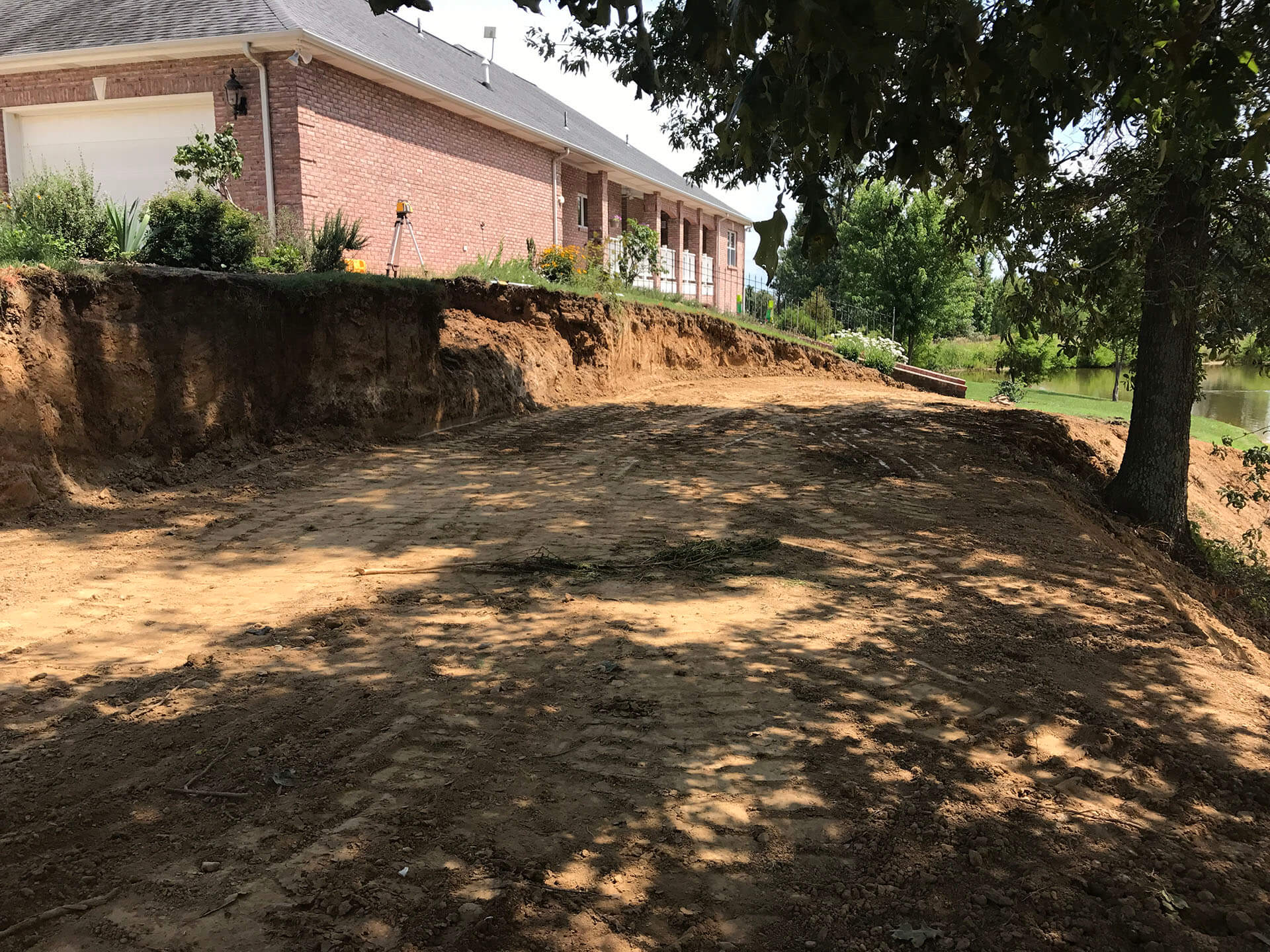 leveling a yard and building a retaining wall Dexter, MO Project